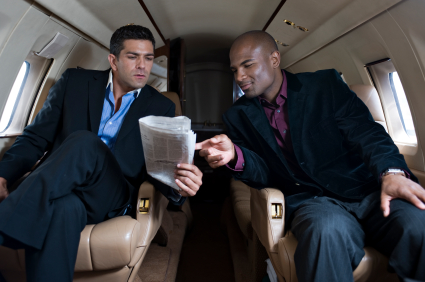 Affluent Travel - Two businessmen in a private jet